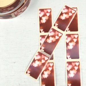 Sticker rechthoek, 25mmx55mm, Warmrood met hartjes print ( per 10 stuks )